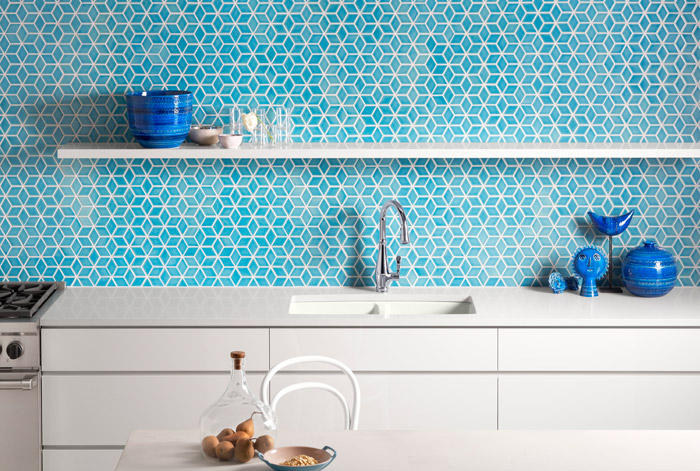 kohler faucet with blue tile backsplash